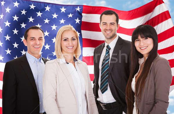 Grupo feliz pie bandera de Estados Unidos negocios Foto stock © AndreyPopov