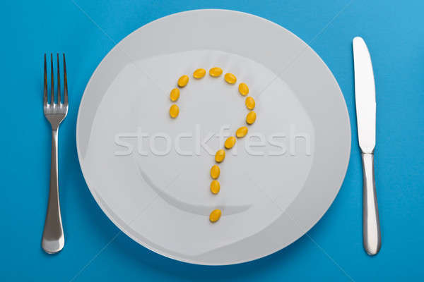Question Mark Made From Pills In Plate Stock photo © AndreyPopov
