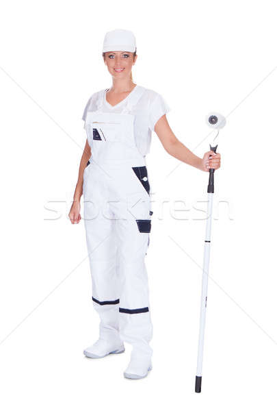 Woman In Protective Clothing Holding Paint Roller Stock photo © AndreyPopov