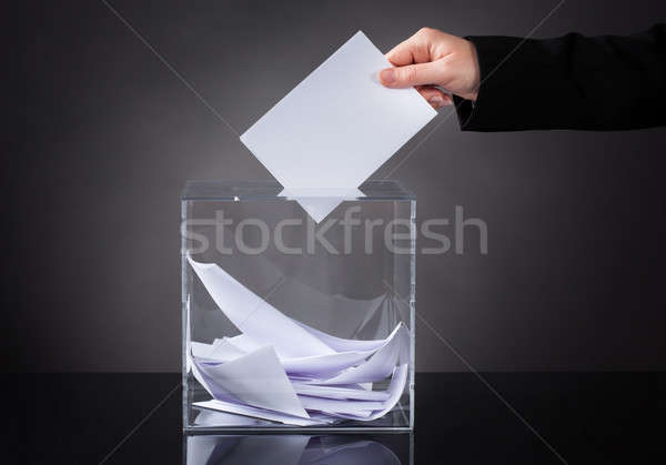 Hand Putting Ballot In Box Stock photo © AndreyPopov