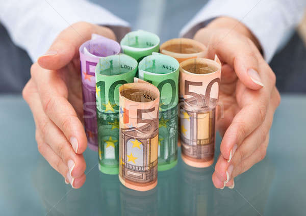 Kéz Euro bankjegy közelkép tekert felfelé Stock fotó © AndreyPopov