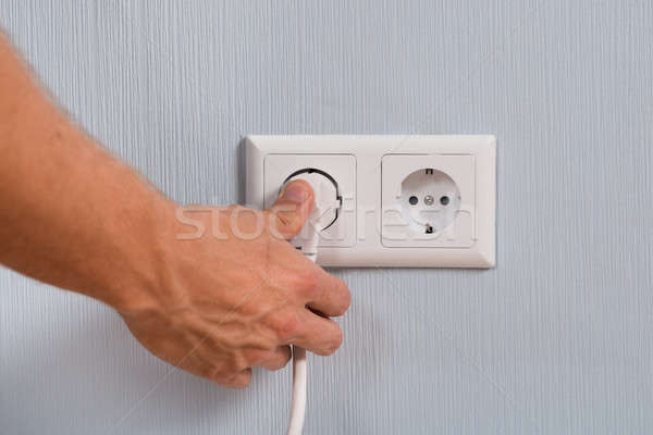 Closeup Of Hand Inserting An Electrical Plug Stock photo © AndreyPopov