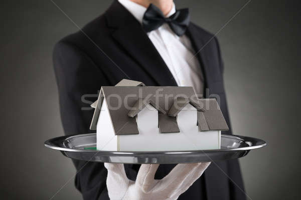 Close-up Of Butler With House Model Stock photo © AndreyPopov