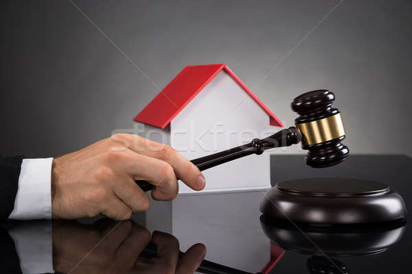 Judge With House Model Hitting Gavel Stock photo © AndreyPopov