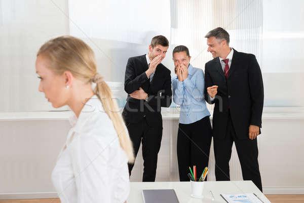 üzletemberek suttog nő csoport boldog iroda Stock fotó © AndreyPopov