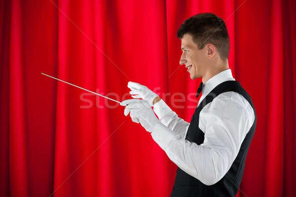 Orquestra masculino vermelho cortina homem Foto stock © AndreyPopov