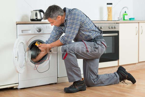 Repairman Checking Washing Machine With Digital Multimeter Stock photo © AndreyPopov
