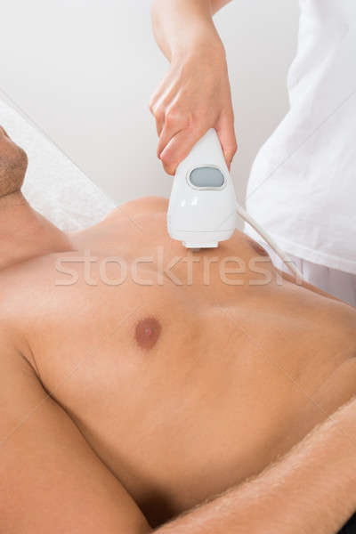Beautician Giving Laser Epilation On Man's Chest Stock photo © AndreyPopov