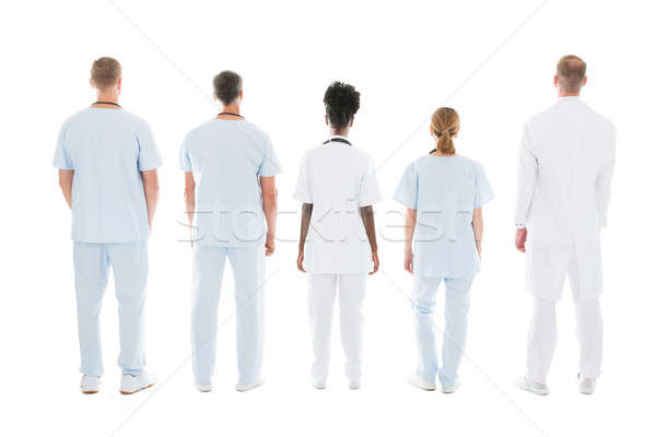 Medical Team Standing Against White Background Stock photo © AndreyPopov