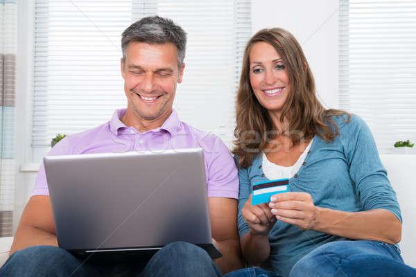 ストックフォト: 成熟した · カップル · ショッピング · を · ノートパソコン · 幸せ