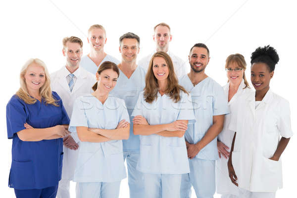 Happy Medical Team Standing Against White Background Stock photo © AndreyPopov