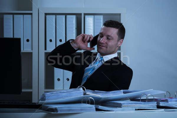 Imprenditore smartphone lavoro tardi ufficio sorridere Foto d'archivio © AndreyPopov