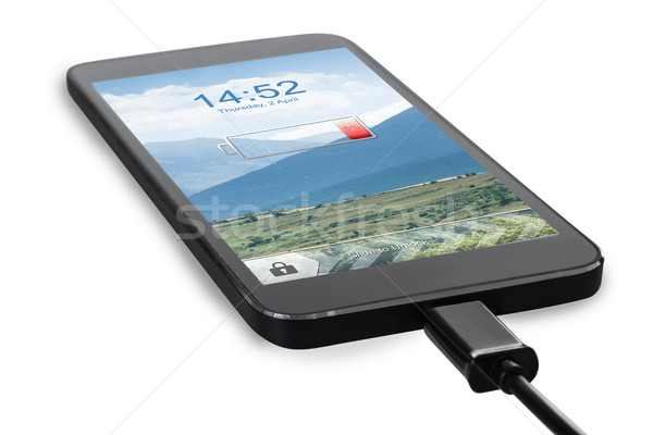 Smart Phone Connected To Charger Stock photo © AndreyPopov