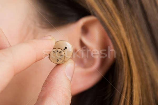 Nő kezek hallókészülék fül közelkép kéz Stock fotó © AndreyPopov