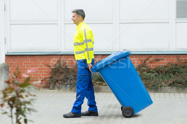 Male Worker Walking With Dustbin On Street Stock photo © AndreyPopov