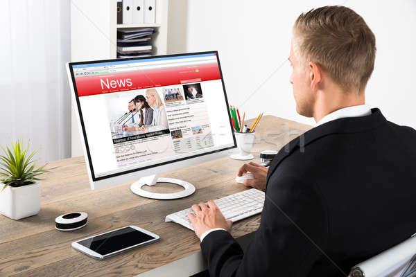 Stock photo: Businessman Reading News On Computer