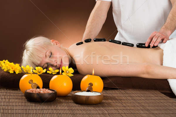 Young Woman Receiving Hot Stone Therapy Stock photo © AndreyPopov
