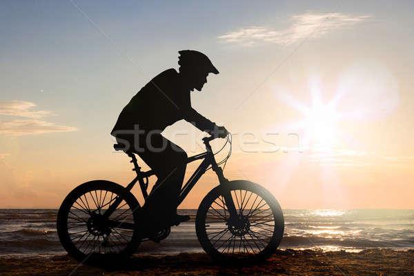 Man Cycling At Beach Stock photo © AndreyPopov