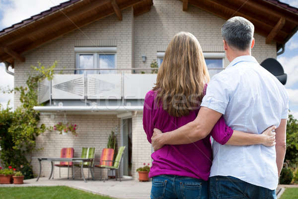 Stock photo: Couple Standing In Front Of Their House