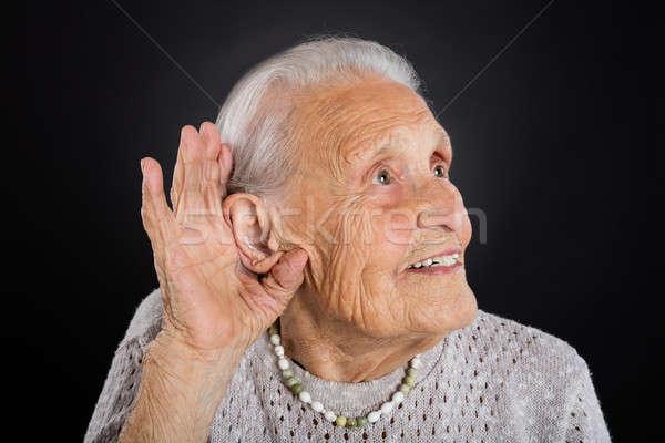Boldog idős nő hall kéz fül Stock fotó © AndreyPopov