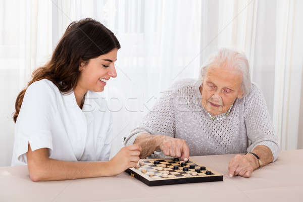 Two Women Playing Checkers Game Stock photo © AndreyPopov