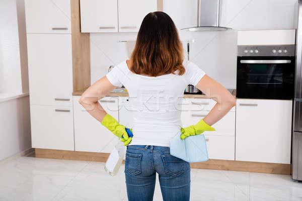 Nő áll konyha termék hátsó nézet modern Stock fotó © AndreyPopov