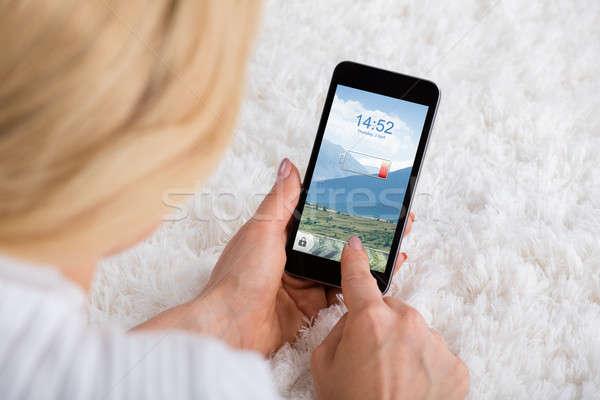 женщину мобильного телефона низкий батареи Сток-фото © AndreyPopov