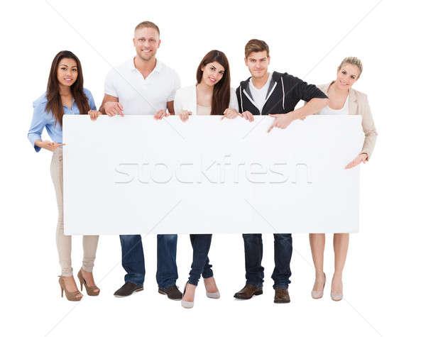 Stock photo: People Holding Billboard On White Background