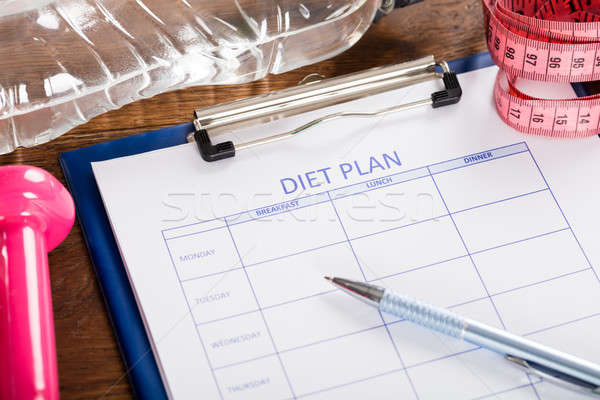 Diet Plan With Dumbbell, Water Bottle And Measuring Tape Stock photo © AndreyPopov
