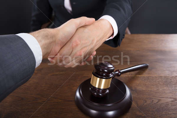 Close-up Of A Client And Judge Shaking Hands Stock photo © AndreyPopov