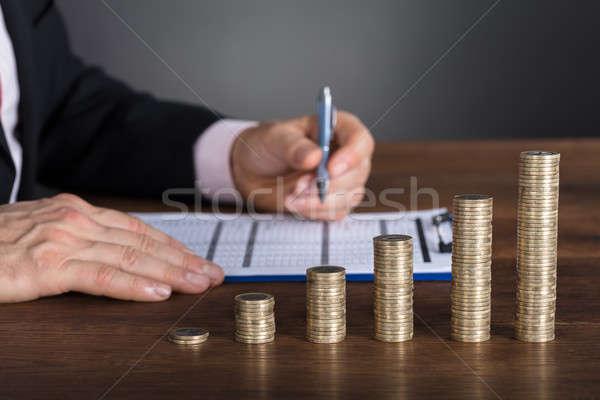 Businessman Calculating Financial Report Stock photo © AndreyPopov