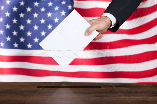 Businessperson Inserting Ballot In Box Stock photo © AndreyPopov