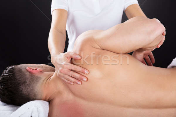 Physiotherapist Doing Treatment On Man's Shoulder Stock photo © AndreyPopov