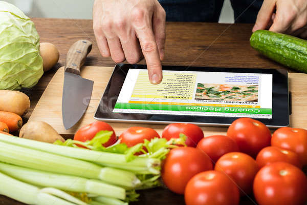 Person Is Preparing Recipe Using Digital Tablet Stock photo © AndreyPopov