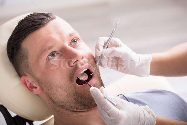 Young Man Having His Dental Checkup Stock photo © AndreyPopov