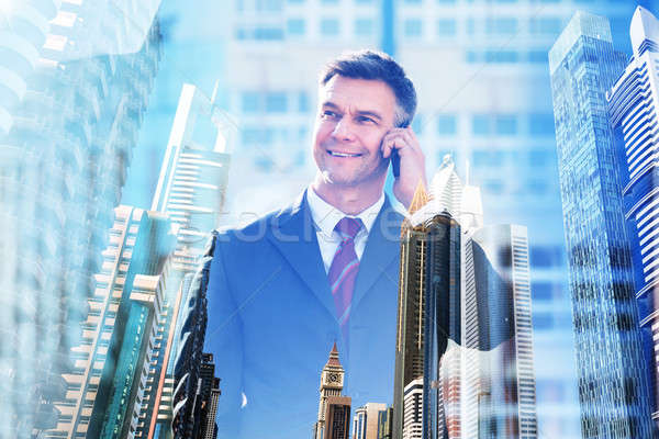 Confident Businessman Talking On Mobile Phone Stock photo © AndreyPopov