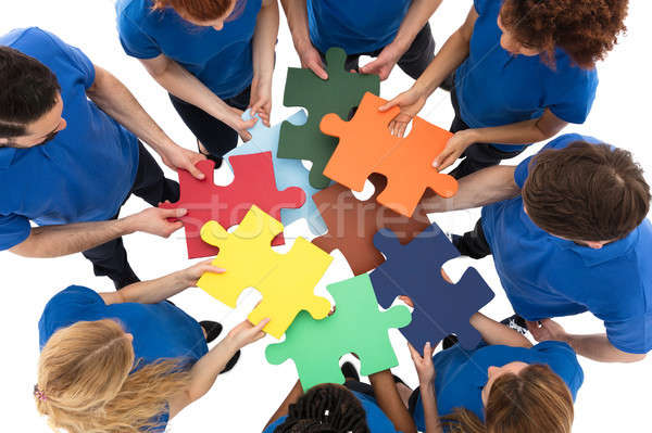 Group Of Janitors With Multi Colored Jigsaw Puzzle Stock photo © AndreyPopov