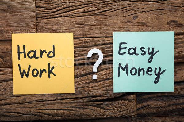 Kemény munka könnyű pénz cetlik kérdőjel közelkép Stock fotó © AndreyPopov