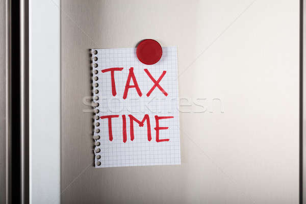 Tax Time Note Attached With Magnetic Thumbtack On Wall Stock photo © AndreyPopov