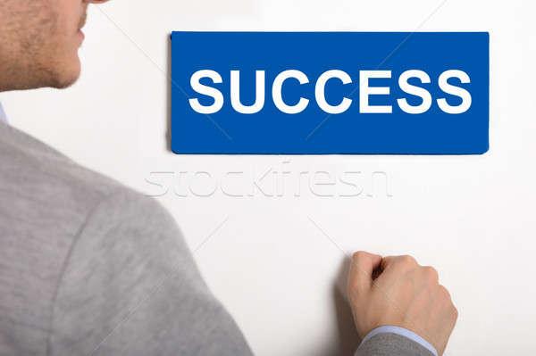 Businessman Knocking Door With Success Text Stock photo © AndreyPopov