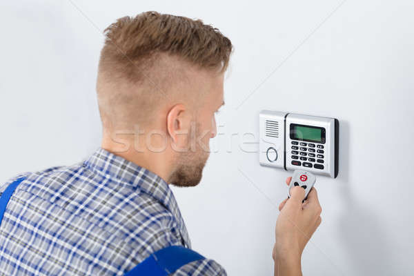 Repairman Using Remote To Operate Security System Stock photo © AndreyPopov