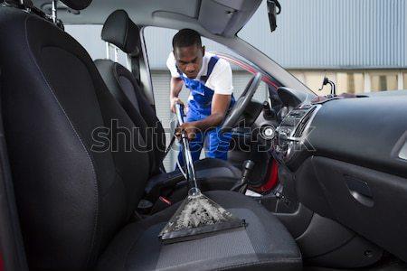 Handyman carro assento jovem aspirador de pó Foto stock © AndreyPopov