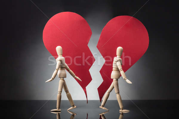 Two Wooden Dummy Standing Against Each Other With Broken Heart Stock photo © AndreyPopov