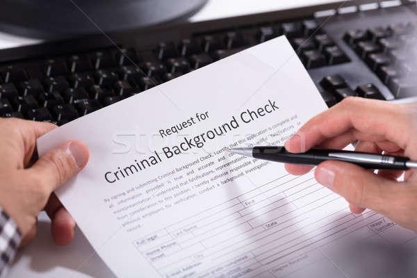 Persona mano riempimento penale verificare applicazione Foto d'archivio © AndreyPopov