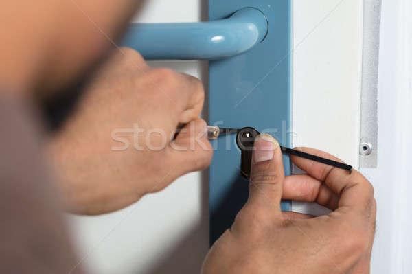 Osoby otwarcie drzwi blokady Zdjęcia stock © AndreyPopov