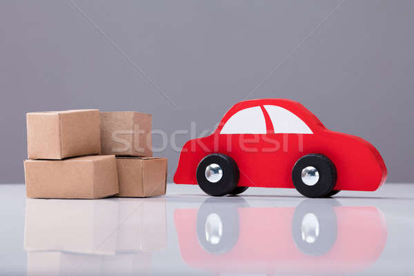 Red Car And Cardboard Boxes On White Desk Stock photo © AndreyPopov