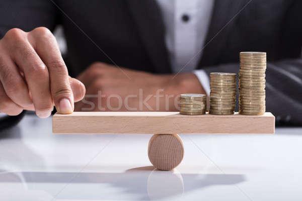 Bilanciamento monete legno altalena Foto d'archivio © AndreyPopov