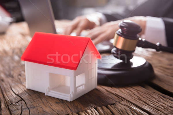Close-up Of House Model And Gavel In Courtroom Stock photo © AndreyPopov