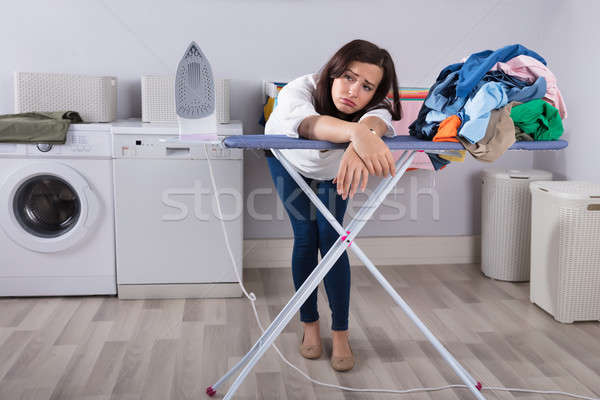 Unhappy Woman Leaning On Ironing Board Stock photo © AndreyPopov