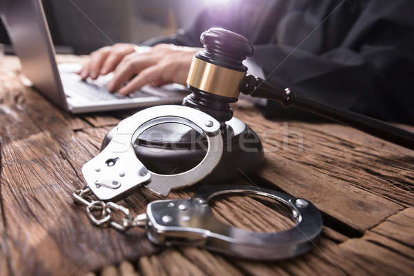 Close-up Of Handcuffs And Gavel In Courtroom Stock photo © AndreyPopov